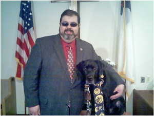 Pastor Darryl Miller and his leader dog, Rowdy.