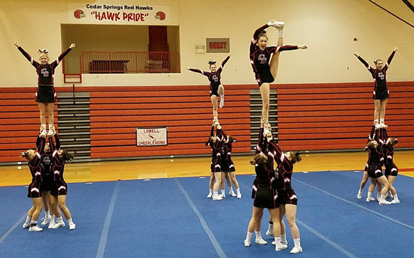 Cedar Springs Varsity Cheer team takes first place at the second OK White Conference meet.