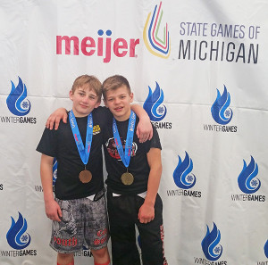 Cedar Springs Youth wrestlers Logan Troupe, 3rd place and Carter Falan, 1st place 2004-2005 Open division, 105lb class at Meijer State Games 2017. Photo by J. Troupe