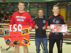 Senior Patrick Depiazza, Coach Nick Emery and Senior Jordan Ringler after the two wrestlers reached 150 wins. Photo by Jane Ringler.