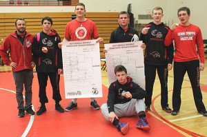 Head Coach Nick Emery (far left) with the six Cedar Springs wrestlers that will be moving on to Regionals.
