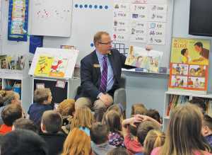 Senator Peter MacGregor read to young students.
