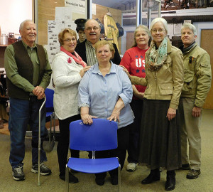 The Cedar Springs Historical Society donated 40 chairs like the blue one in this photo to the Cedar Springs Library. From left to right is Fred Gunnell, CS Historical Society; Amy Hall, CS Library Board; Jerry Hall, Mayor, CS City Council; Sharon Jett (in front of Jerry), CS Historical Society; Tanya Eldred, CS Historical Society; Donna Clark, CS Library Director; Dan Clark, Cedar Springs City Council. Post photo by J. Reed.