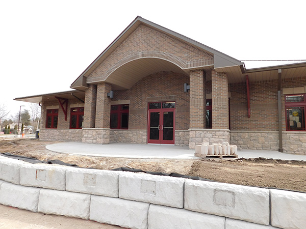 The new Cedar Springs Community Library is nearing completion, and will be opening in May. This is a view from the back, with the retaining wall where the plaques will be. Post photo by J. Reed.