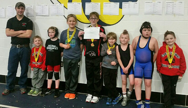 Cedar Springs Youth wrestlers and their medals. L-R: Coach Jake Marsman, Wyatt Dickinson, Deegan Pike, Gabe Gair, Cole Haack, Cade Troupe, Chasyn Winchel, Dakota Winchel, William Dickinson. Photo by J. Troupe.