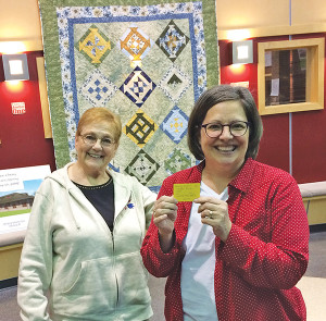 Kat Pont, right, with Louise King, left, was the winner of the quilt that was raffled off at the library fundraiser.