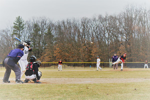 JV pitcher Peyton Newman delivers a fastball to catcher Seth Biggs last week against the Newaygo Lions.