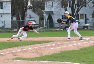 Peyton Newman turns back from a lead off in Friday's win over North Muskegon.