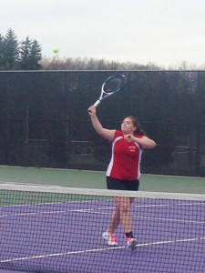 Mandi Titus, one half of the number three doubles team at Cedar Springs, returns a ball during the match at Greenville. Courtesy photo.