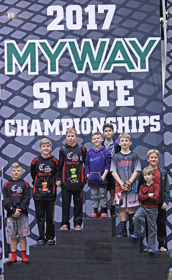CS Youth Wrestlers at State Finals last weekend. L-R: Carter Falan, Ben Brunner, Trevor Marsman, Blake Falan, Tommy Stevens, Logan Troupe, Gabe Gair, Cade Troupe. Photo by J. Troupe.