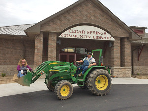 ABOVE: Julie Wheeler and Kurt Mabie, with the Community Building Development Team, are part of a group of volunteers that have been busy landscaping the area around the library this week to get ready for the grand opening. Courtesy photo.