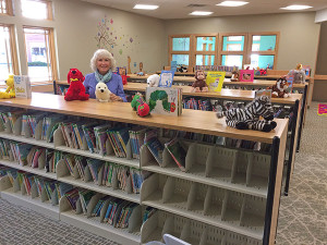 LEFT: Retired Cedar Springs kindergarten teacher Cheryl Tacoma recently donated books and animals to help decorate the new children's area at the library. Courtesy photo.
