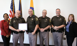 Alicia Sledge (left) and Julie Roth of the Michigan Office of Highway Safety Planning present a national traffic safety award to the Kent County Sheriff's Office. Photo courtesy of OHSP.