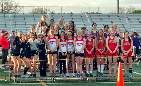 Cedar Springs girls 1600-meter relay track team (the four in the middle) came in fifth at conference.