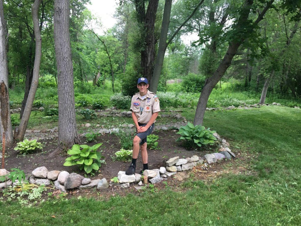 Zach and the completed garden