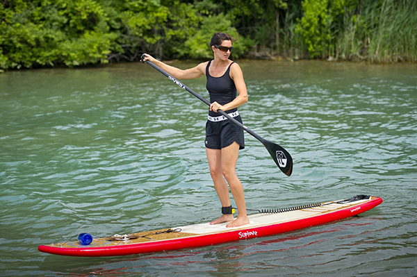 woman paddle boarding on Detroit River