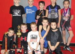 Youth wrestlers earn medals, host tournament