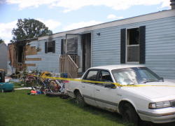 Man pleads guilty in mobile home fire