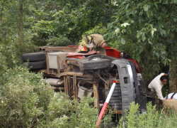 Two hurt in road commission rollover
