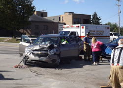Vehicles collide at Main and Muskegon St.