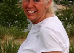 Woman killed in Howard City crash