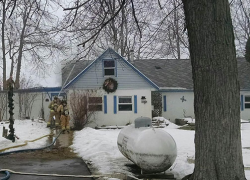 Firefighters save home on Scram Lake