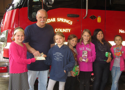 Brownie troop donates to Fire departments