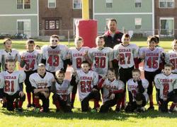 Rocket football team completes undefeated season