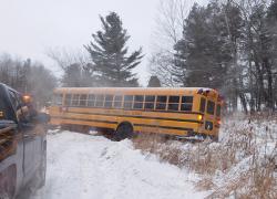 Bus slides off road