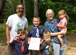 Cub Scout presents check to Nature Center