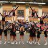 Red Hawk cheer teams tear up the mat