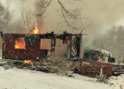 Fire destroys Sand Lake home