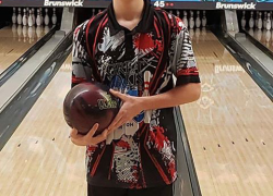Teen bowls near perfect game