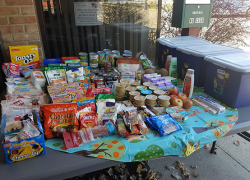 Sand Lake sets up giving table and little library