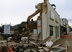 Building torn down to make way for drain