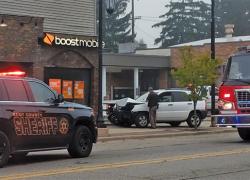 Woman crashes car into building