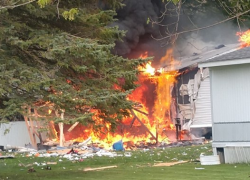 Man injured in explosion, house fire
