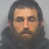 Man sentenced on pipe bomb, gun charges